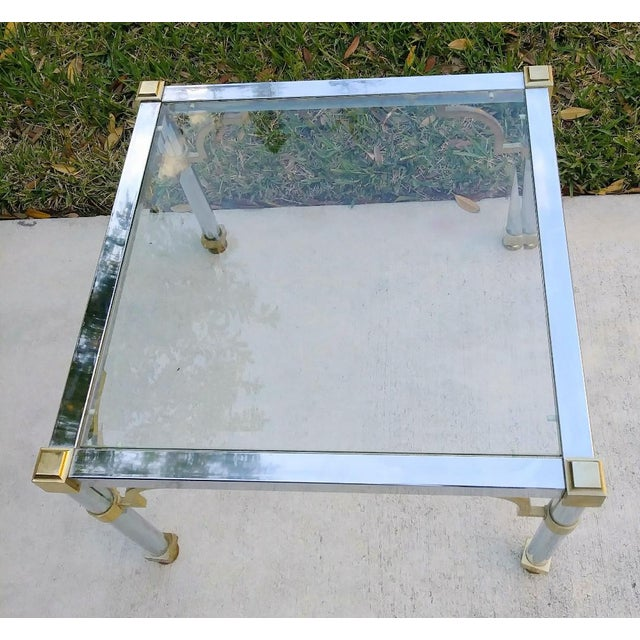 Master craft chrome and brass glass top side end table. This end table has the classic master craft chrome body with brass...