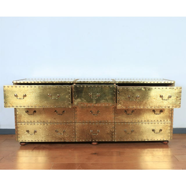 Vintage Brass Cabinet Styled After Sarreid LTD . This piece has a style of smoked Brass spots which brings out a vintage...