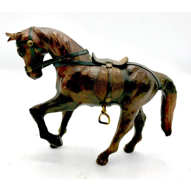 This beautiful horse figurine was created in extreme detail of a beautiful Chestnut riding horse complete with Saddle and...