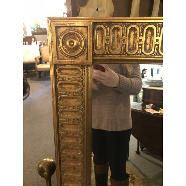 Large Egyptian inspired French Empire oversized gilt mirror. Hand carved in wood.