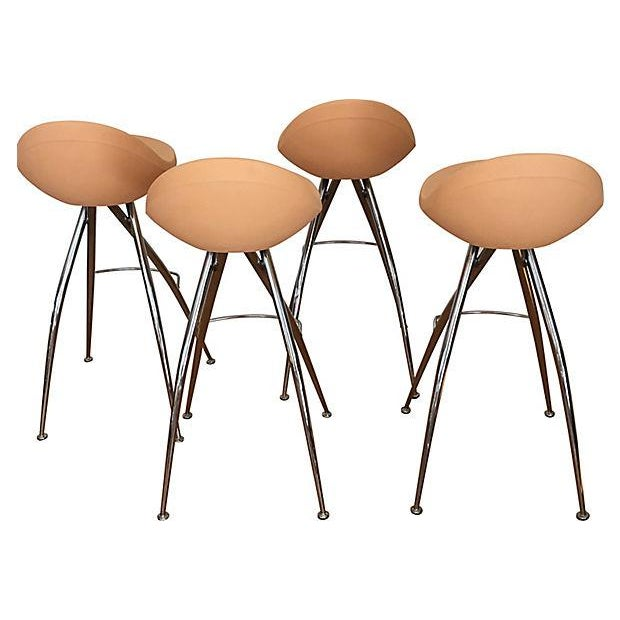 Set of four Midj contemporary peach-colored bar stools by Roberto Foschia with molded plastic seats and chrome spider-...