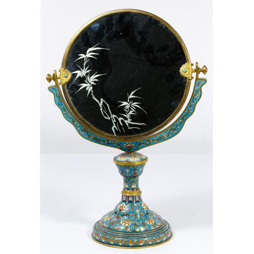 Chinese vanity mirror adorned with floral cloisonné enamel Chinese, early 20th century This strikingly beautiful vanity...