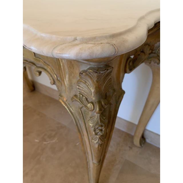 Neoclassic, Louis XV style marble top gilt wood console table. Beautiful ribbon-like, shell-like, and floral hand carved...