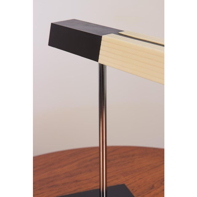 Super cool, post-modern desk lamp for Lightolier. This 1970s table lamp has a rotating neck to adjust the geometric plexi...