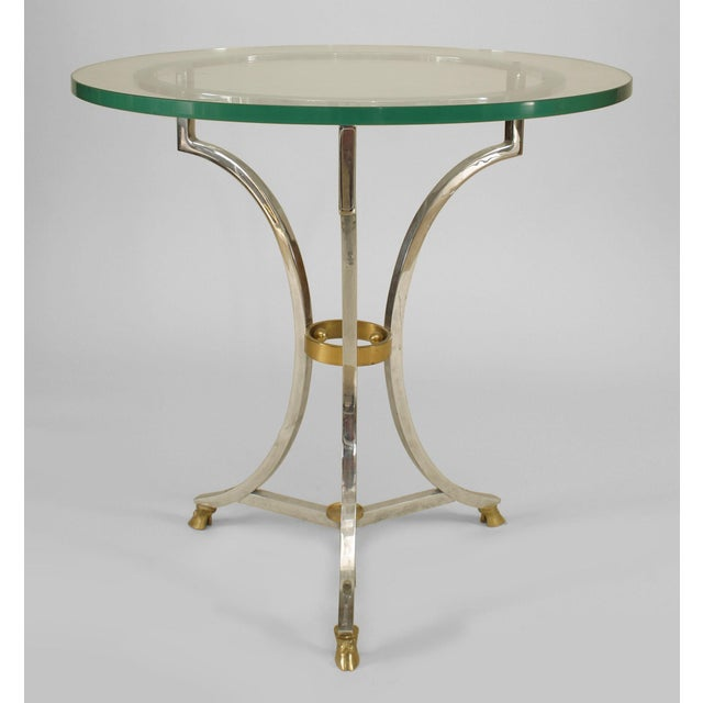 French 1950s end table with a nickel plated base having 3 legs connected with a small ring stretcher and 3 hoof feet...