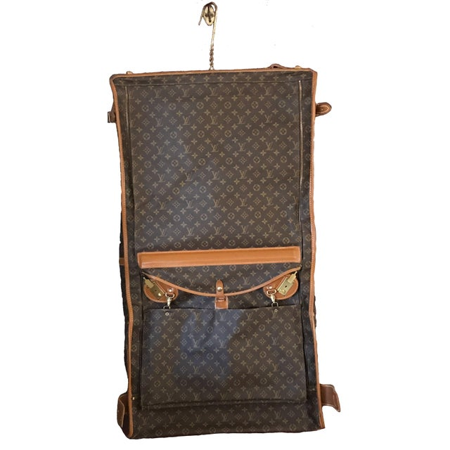 This Gorgeous garment bag is considered a collector's item, and considering it is half a century old, it is in excellent...