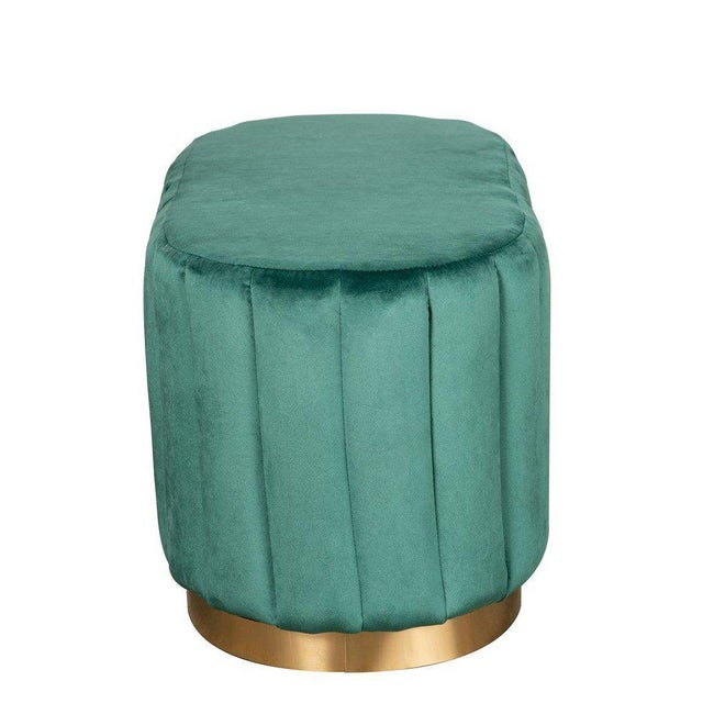 Channel tufted oval ottoman with gold metal base offers chic versatility—it easily transitions from ottoman to a bench or...