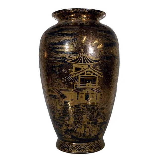 A hand-painted porcelain vase in black and gilt from China in the late 20th century. This vase adopts a traditional shape...