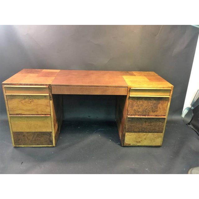 Beautiful burled wood patchwork design desk with seven drawers. The centre is covered in deep brown leather in the front...