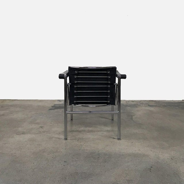 https://chairish-prod.freetls.fastly.net/image/product/sized/d7957275-b91c-4a1d-82dc-f0593b641792/cassina-le-corbusier-pierre-jeanneret-and-charlotte-perriand-lc1-black-cowhide-armchair-7831?aspect=fit&width=640&height=640
