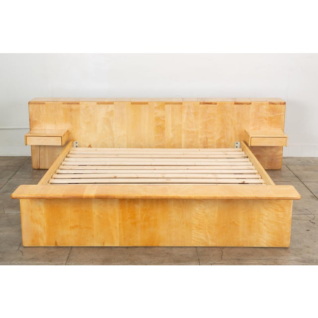 A generously proportioned platform bed by California designer and woodworker Gerald McCabe for his company, Erin...