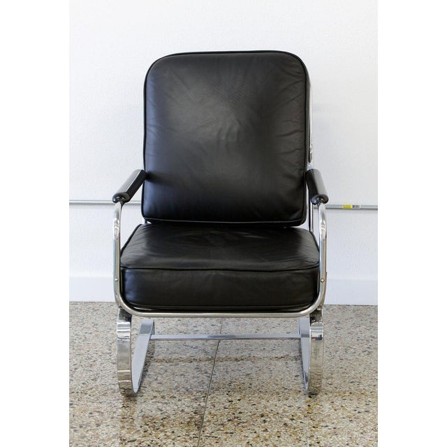 The Springer armchair designed by KEM Weber for Lloyd Manufacturing, circa 1935. Reupholstered in black leather, the...