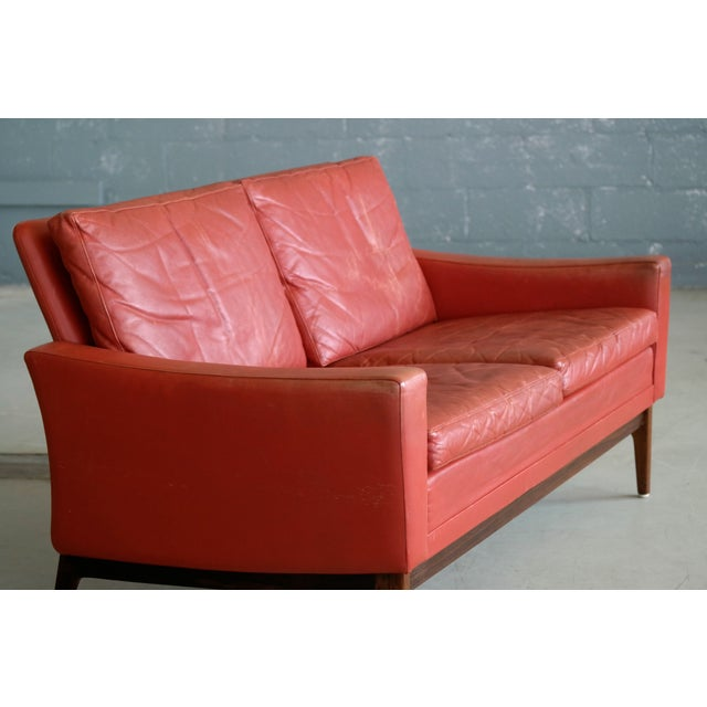 Classic Danish Mid-Century Modern Sofa in Red Leather and Rosewood Base For Sale In New York - Image 6 of 11