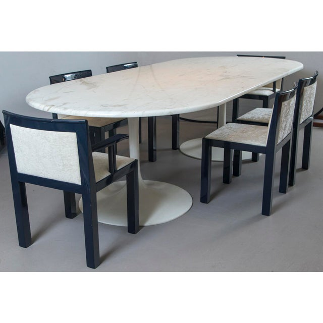 Mid-century tulip dining table bases attributed to Eero Saarinen with custom marble top.