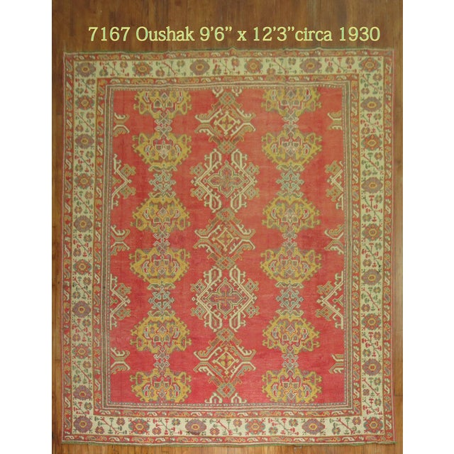 Early 20th century one of a kind Antique Turkish Oushak rug. Very colorful with an all over crab motif.