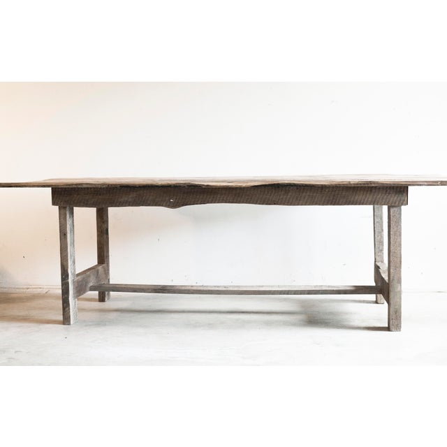 From Archaic Custom comes this French Country table fabricated to order of antique reclaimed barn wood. The table's sturdy...