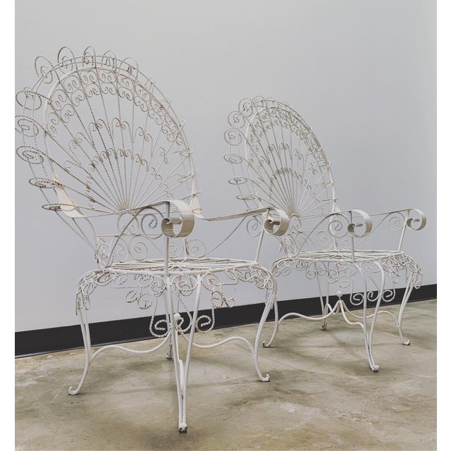 Pair of Vintage Salterini Iron Peacock Chairs! Intricately twisted iron that gives a whimsical feel! Painted white and...