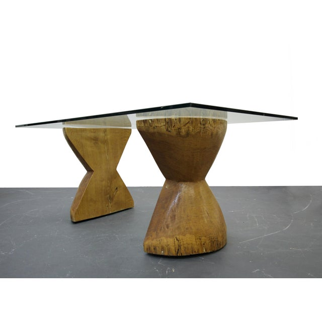 Completely unique and one of a kind twist to your traditional live edge table. These hourglass shaped pieces are solid...