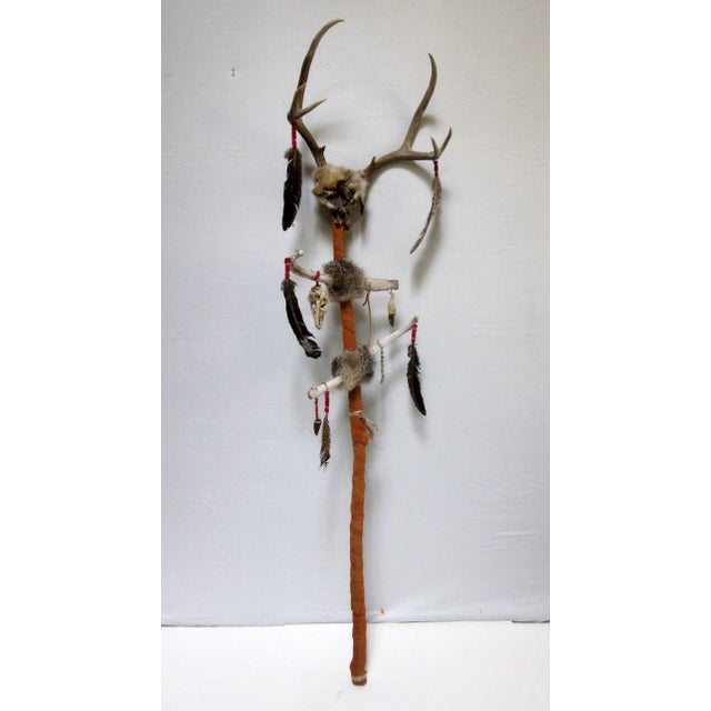 Ceremonial stick or trail marker. Wrapped in leather, the top is adorned with genuine antlers. Please take a look at our...