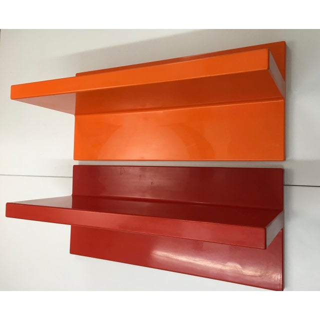 A pair of structurally sturdy and stable vintage plastic wall-mounted shelves manufactured by Kartell. From the 1970s,...
