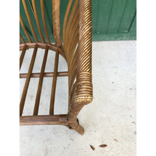 Original bamboo chair and cushion. It's a very large chair in good condition considering its age and use.
