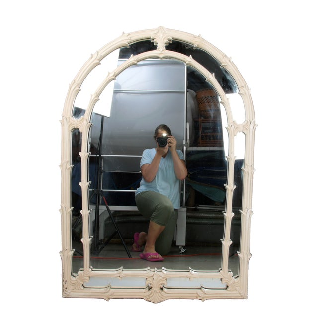 A pair of 1970s-era Hollywood Regency-style arched mirrors by Gampel-Stoll. One is marked and dated on the back. This set...