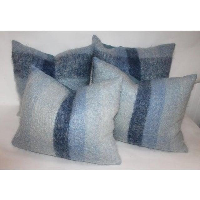 These two pairs of soft mohair or lambs wool pillows are in fine condition and have robin egg blue cotton linen backings....