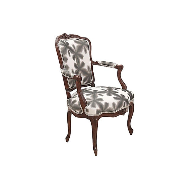 """A pair of French Louis XV style fauteuils. Newly upholstered in Scalamandre's """"Misterioso"""" fabric in front, framed with..."""