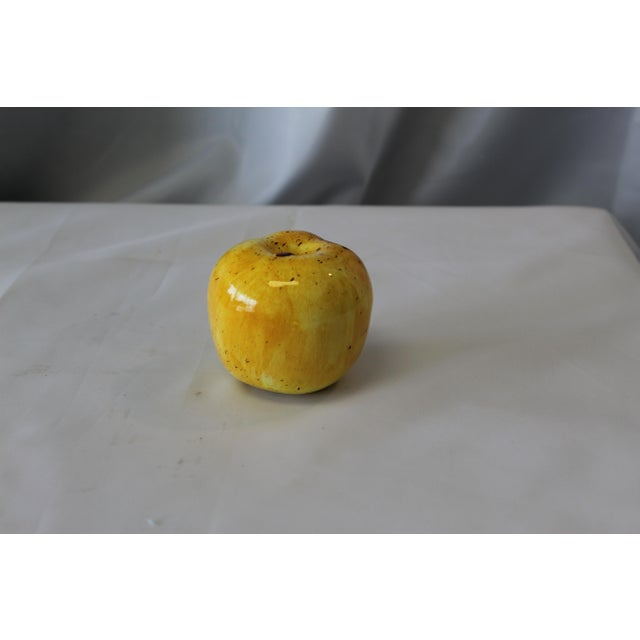 This beautifully and highly detailed Italian ceramic yellow apple is the perfect piece to add to a fine ceramic art...
