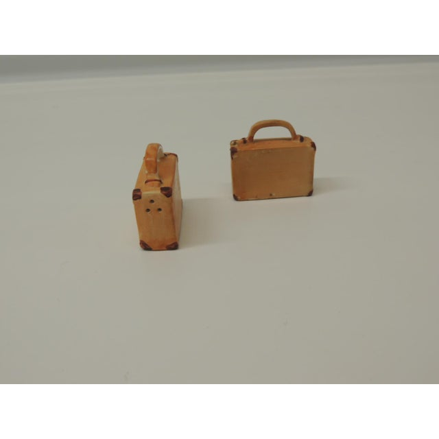 """Pair of orange and brown bisque porcelain trendy handbags salt and pepper Shakers Size: 1.5"""" x 1.5"""" x .5."""