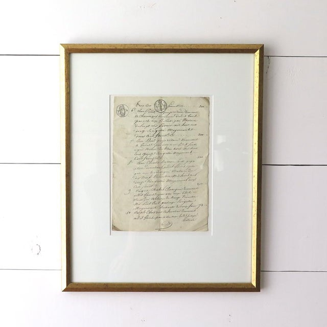 Antique 19th Century French document in metallic gold contemporary frames make an elegant display. This original paper...