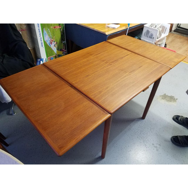 A compact Danish Modern dining table in teak. This table was built in Denmark in the 1960s.