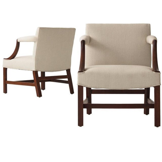 Edward Wormley (1907 - 1995) Pair of upholstered chairs with concave armrests, raised on carved square mahogany legs with...
