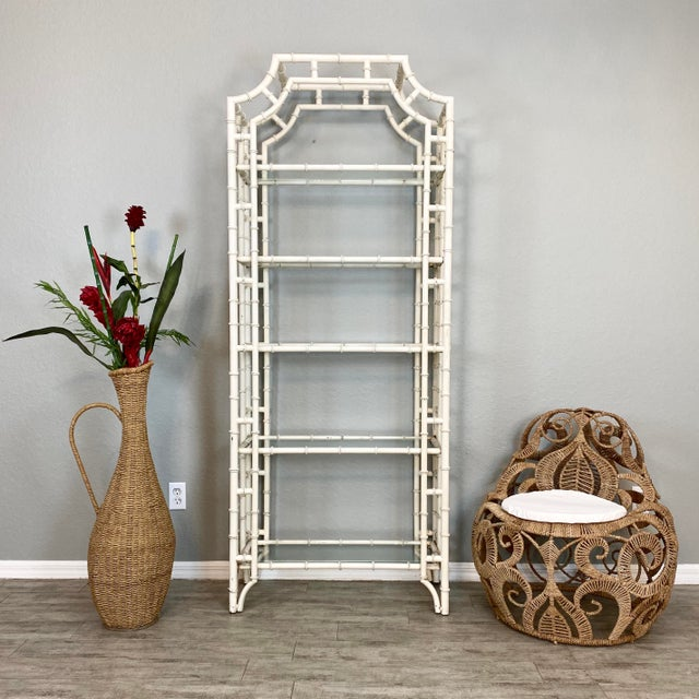 Vintage mid century modern chippendale faux bamboo iron etagere w/ 5 glass shelves. Solid and heavy. In amazing condition....