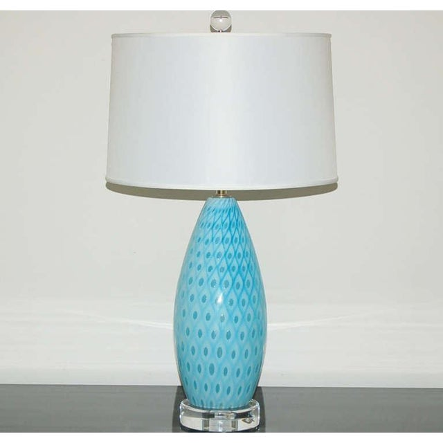 Blown by Galliano Ferro in the 1950's, these beautiful SEA BLUE Venetian glass table lamps are in their iconic peacock...