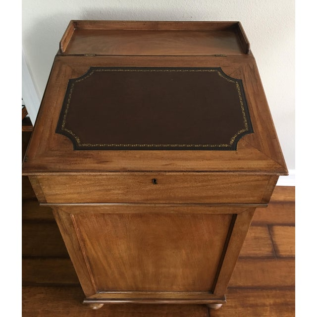"""The Davenport desk (also called a Captain's desk) is """"a small desk that was designed with an inclined lifting desktop""""..."""