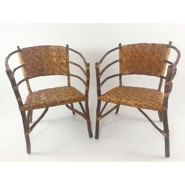 Matching set of Old Hickory style barrel backed arm chairs Wear to varnish on cane, but the cane is in otherwise excellent...