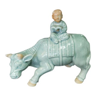 1900s Chinese Celadon Glazed Porcelain Boy Sitting Atop Ox Figurine For Sale