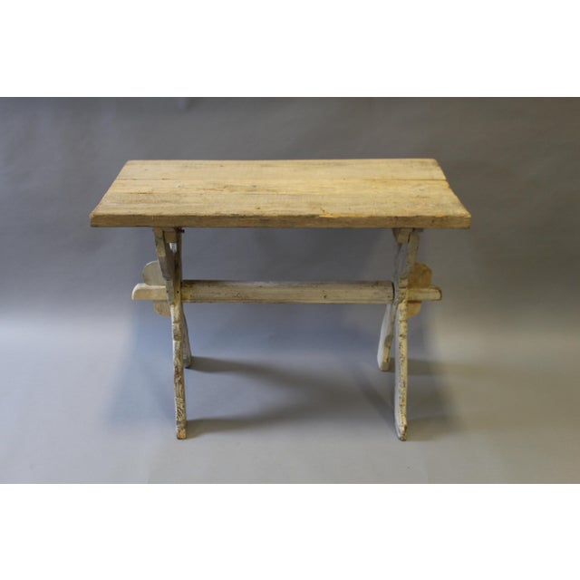 Early 19th century table with a trestle base. Love the bleached wood on this table. Slight wobble in the table but that is...