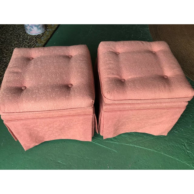 Vintage pink tufted skirted upholstered ottomans in as found condition. The ottomans have some fading in color on several...