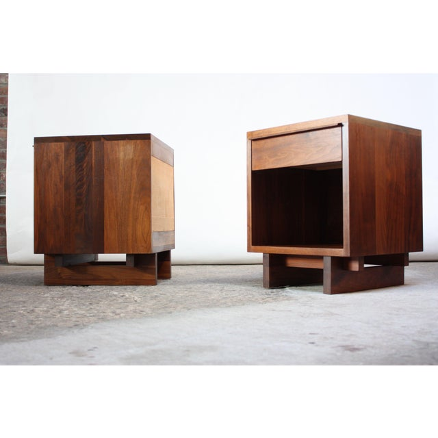 Pair of solid walnut nightstands with linear sculptural pulls designed and manufactured on custom order by Vermont...