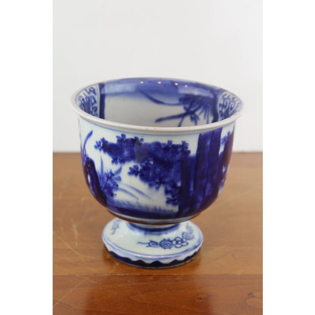 Antique Chinese blue and white porcelain footed bowl with countryside scenes. A beautiful display item!