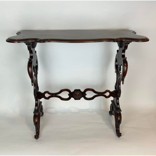 Classic and graceful lines make this 19th Century side table very pleasing. Its stunning original antique finish has a...