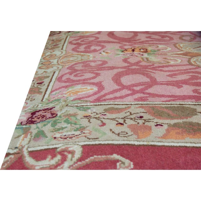 High quality rug made in Romania. This magnificent work of revival art features a french Savonnerie design with a...