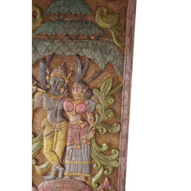 Indian carved wood wall panels of Krishna Radha spending time with each other under Kadambari tree . The pair of spiritual...
