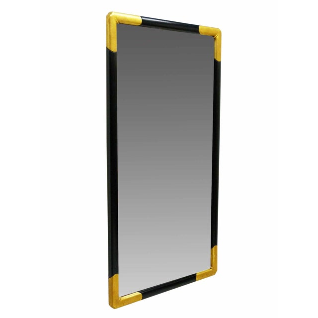 """A vintage 46"""" black frame with gilt corners rectangular wall mirror by Milch & Son. Light scuffs to paint."""