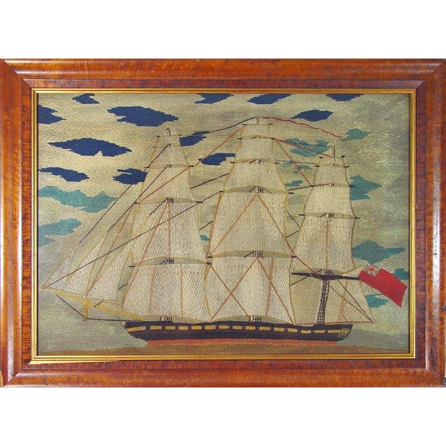 The early Sailor's woolie executed in a cross-stitch depicts a Royal Navy Red Fleet frigate sailing from right to left...