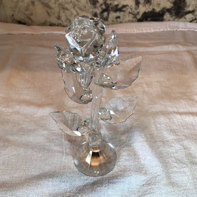 This is a very delicate, beautiful rose stem crafted from sparkling crystal. It's quite unusual and unique. The piece is...