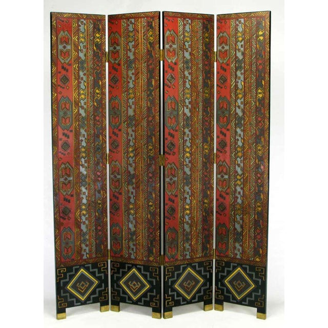 Carved wood and parcel gilt four-panel screen with muted lacquer coloring of persimmon, teal, black and taupe. The back is...