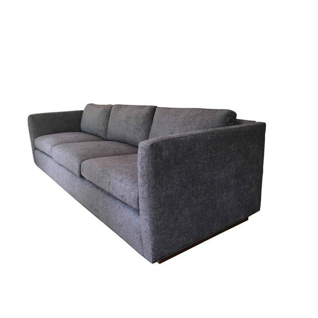 Stunning three-seat tuxedo Sofa designed by Milo Baughman for Thayer Coggin. Wood plinth base is raised on casters for a...